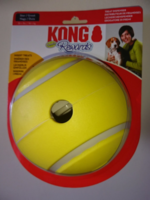 Yellow rubber Kong Tennis Rewards Ball with a circular hole for treats