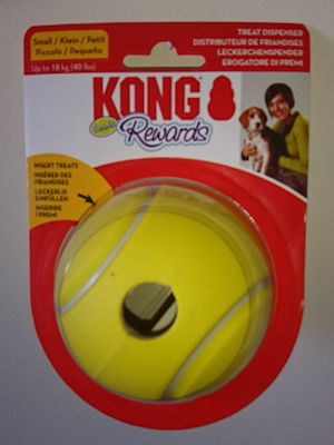 Yellow tennis ball patterned rubber Kong Tennis Rewards Ball with hole for treats